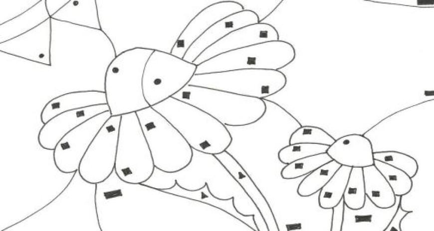 Květina ukrytá na louce